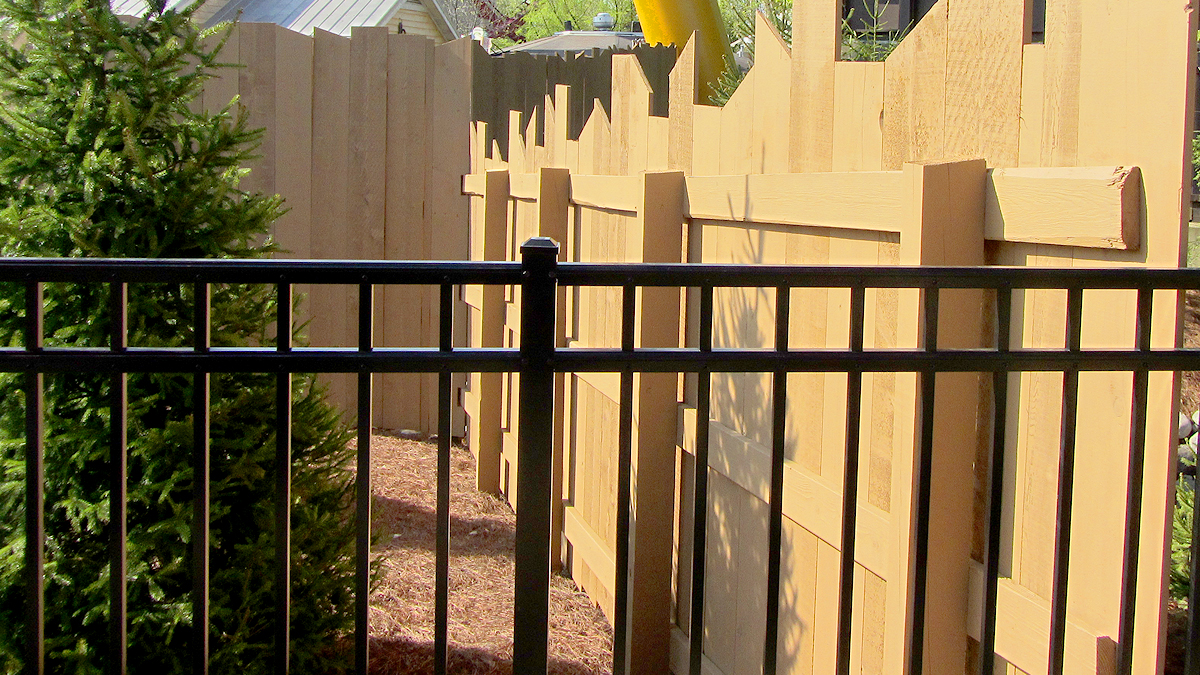 Aluminum fencing blends beautifully with existing fencing.