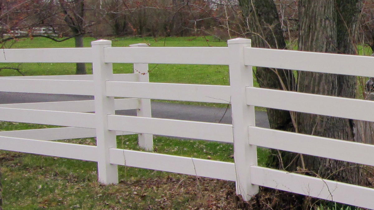 Vinyl fences come in a variety of styles and colors including this classic four rail fence.